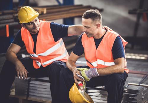 construction worker serious conversation
