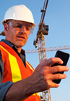 Construction Worker Holding Phone